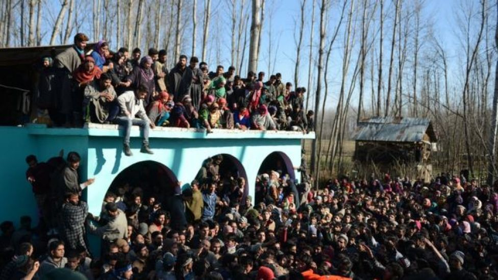 Kashmiri villagers attend the funeral for suspected rebel Shariq Ahmed Bhat at Bandana village of Pulwama district, south of Srinagar, on January 20, 2016.
