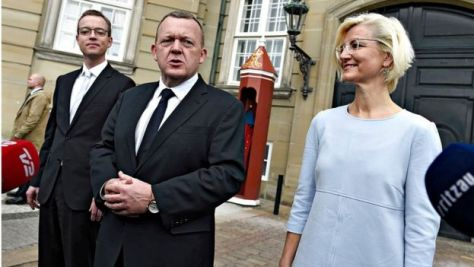 Danish Prime Minister Lars Lokke Rasmussen (C) presents Esben Lunde Larsen as new Environmental and Food Minister (L) and Ulla Tornaes as new Minister of Higher Education and Science in front of Amalienborg Castle in Copenhagen February 29, 2016