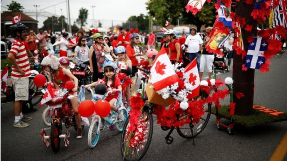 Children prepare to participate in the East York Toronto Canada Day parade, as the country marks its 150th anniversary with