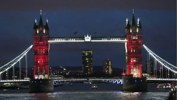 Tower Bridge in London lit up in the colours of the French flag