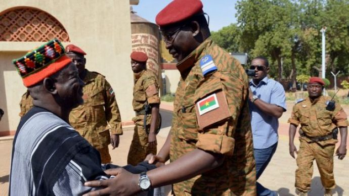 Mogho Naba (left) greets Burkina Faso's army leader, Lt-Col Isaac Zida in the royal courtyard in Ouagadougou (04 November 2014)