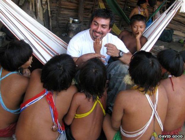 David entertains some villagers