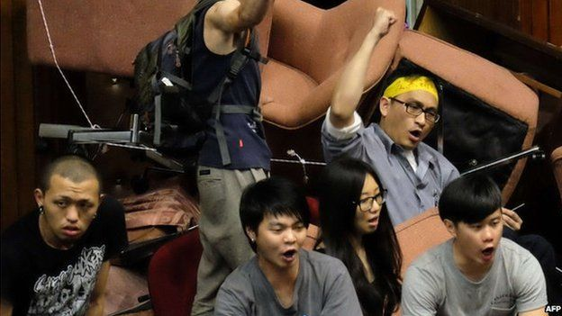 Protesters chant slogans during an anti-China demonstration at the Parliament in Taipei on 19 March 2014