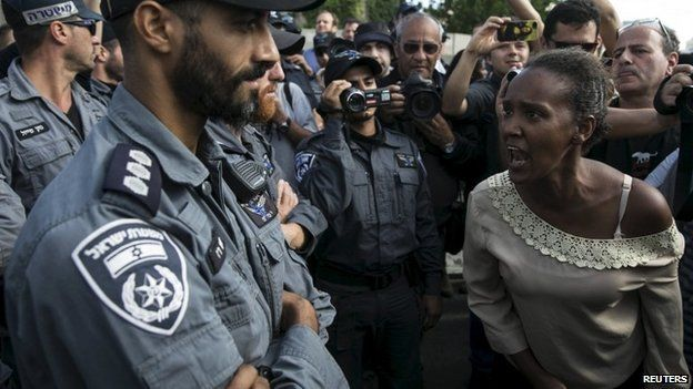 A protester, who is an Israeli Jews of Ethiopian origin, shouts at a policeman during a demonstration in Tel Aviv May 3, 2015.