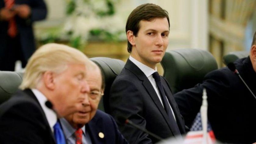 White House senior advisor Jared Kushner (C) sits alongside U.S. President Donald Trump (L) and Commerce Secretary Wilbur Ross (2nd L)