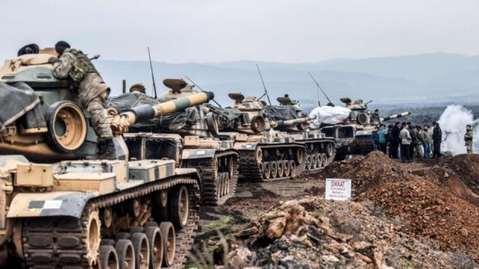 Turkish troops gather near the Syrian border at Hassa, in Hatay province, 21 January 2018