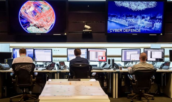 People sit at computers in the 24 hour Operations Room inside GCHQ, Cheltenham on 17 November, 2015.