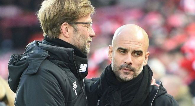 Manchester City manager Pep Guardiola (right) with Liverpool boss Jurgen Klopp
