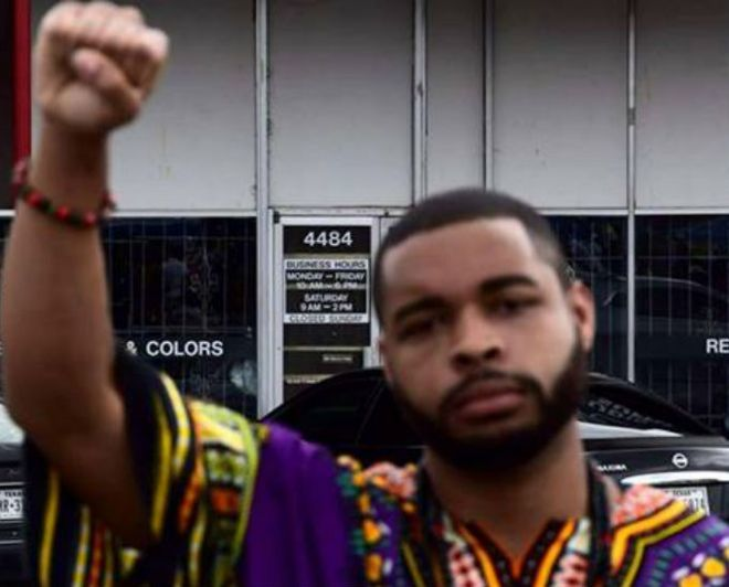 Images from the Facebook page of Micah Johnson showing him giving a 'black power' salute