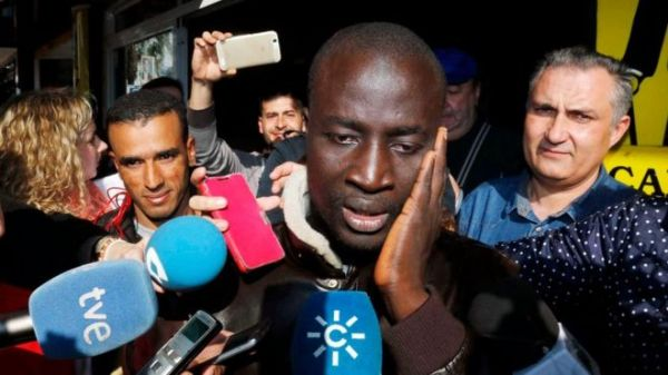 Senegalese man reacts after discovering that he has one ticket of the number 79,140, the first prize of El Gordo Christmas lottery, in Roquetas de Mar, Andalusia, southern Spain, 22 December 2015.