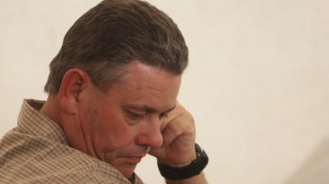 Theo Bronkhorst a professional hunter appears at the magistrates court on the first day of trial in Hwange about 700km south-west of Harare, Zimbabwe, Monday 28 September 2015