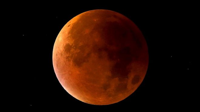 A lunar eclipse coincides with a supermoon in Newcastle-under-Lyme, Staffordshire, England, 28 September 2015.