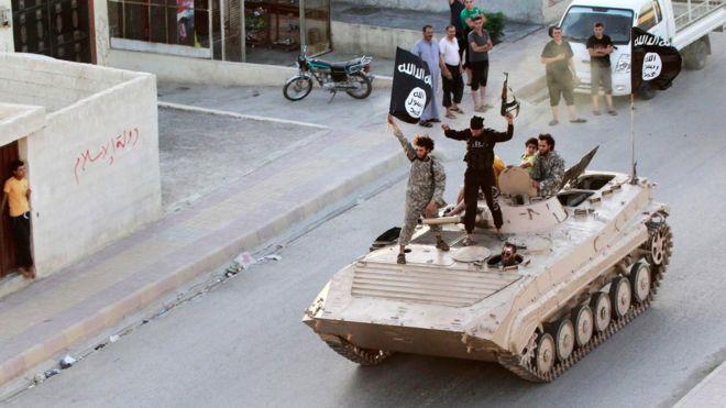 Islamic State militants in Raqqa, Syria (30 June 2014)