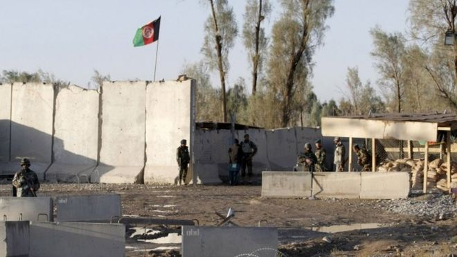 Afghan security forces stand guard at the entrance gate of Kandahar Airport (09 December 2015)