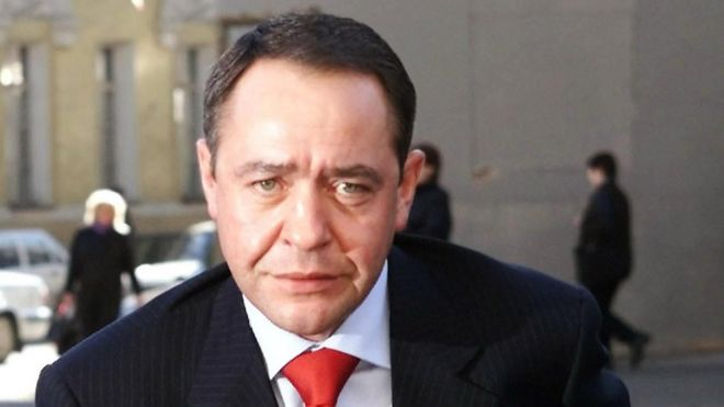 """Russia""""s Mass Media Minister Mikhail Lesin enters his ministry in central Moscow, in this file photo from March 27, 2002"""