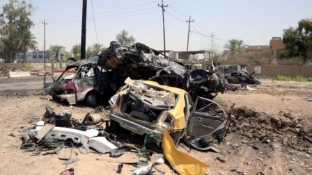 Destroyed vehicles are seen at the site of a suicide car bomber in Khalis, north of Baghdad, Iraq, July 25, 2016.