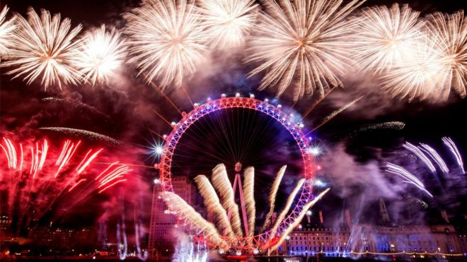Fireworks surrounded the London Eye during New Year celebrations