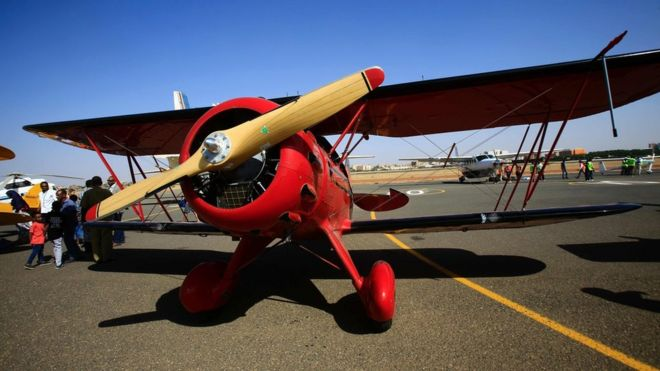 A Waco YMF-5D biplane sits on the runway on November 20, 2016 in Khartoum airport during the Vintage Air Rally (VAR).