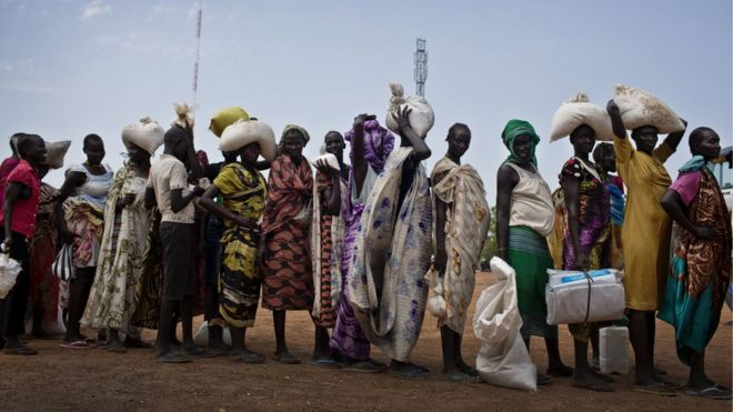 Women who have fled fighting in South Sudan queue for food aid, 19 October 2016