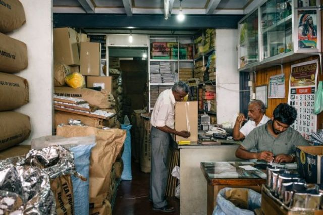 Workers work in a tea shop in Kandy