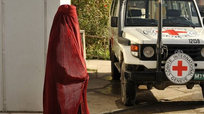 File photo of pedestrian passing vehicle at the International Committee for the Red Cross (ICRC) office in Kabul.