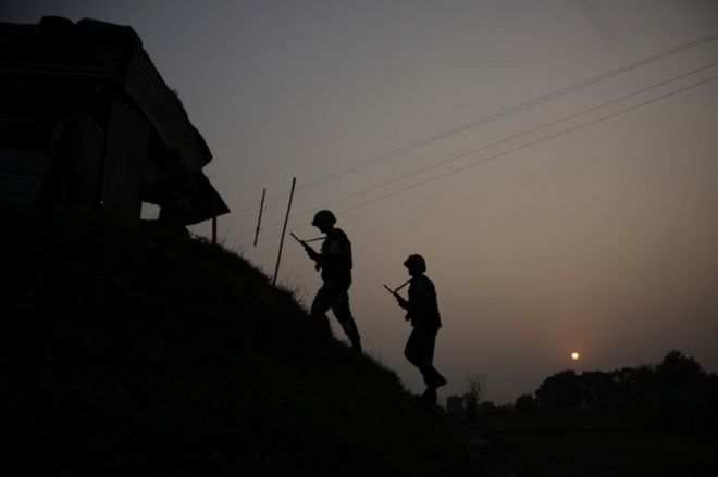 Indian Border Security Force soldiers patrol near the India-Pakistan international border area at Gakhrial boder post in Akhnoor sector, about 48 kilometers from Jammu, India, Saturday, Oct. 1, 2016. In