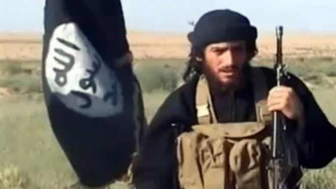 This file image shows an image grab taken on October 2, 2013 from a video uploaded on YouTube on July 8, 2012, of the spokesman for the Islamic State of Iraq and the Levant (ISIS), Abu Mohammad al-Adnani