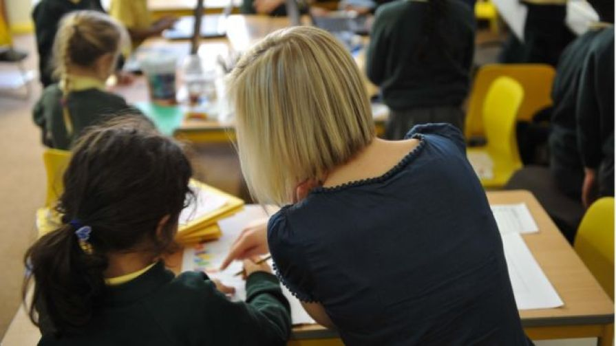 Primary teacher with pupil