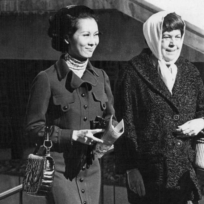 NOV 19 1970; Mrs. Nguyen Cao Ky, left, is escorted by Mrs. Albert P. Clark, wife of the air force Academy superintendent as they began a tour of the AFA Campus