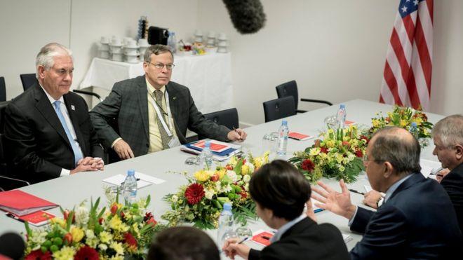 Rex Tillerson (L) meets Sergey Lavrov (second right)