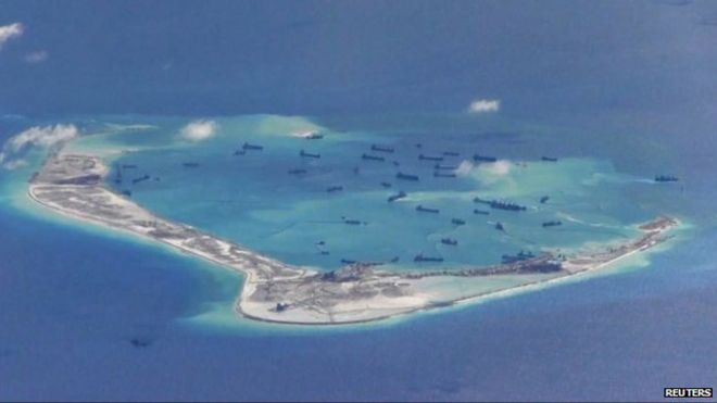 US Navy photo purportedly showing Chinese dredging vessels