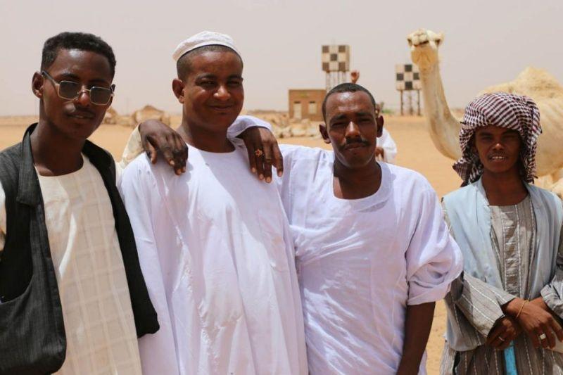 Vendors and a rogue interloper at the camel market near Khartoum