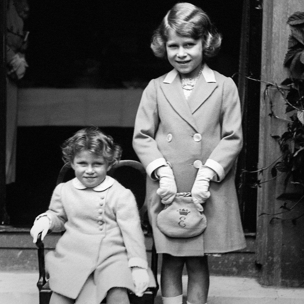 Two year old Princess Margaret (seated) with her sister Princess Elizabeth