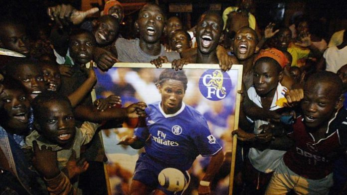 Fans in Ivory Coast with a Didier Drogba banner