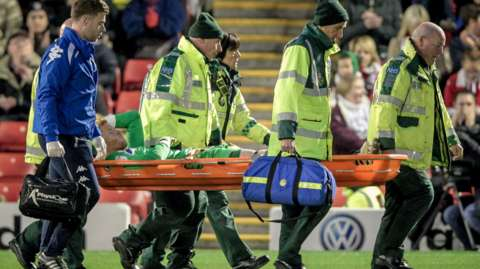 Adam Bogdan is carried off on a stretcher
