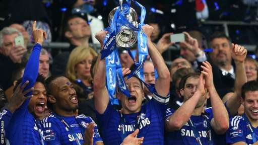 John Terry lifts the trophy
