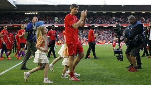 Steven Gerrard applauds the Kop