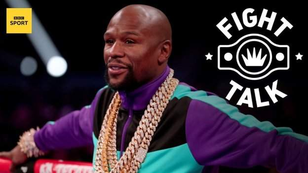 sport Former world champion Floyd Mayweather leans against the rope while wearing a gold chain an tracksuit top