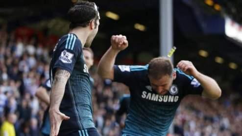 A cigarette lighter can clearly be seen striking Chelsea defender Branislav Ivanovic