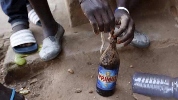Protesters who are against President Pierre Nkurunziza prepare a petrol bomb in Bujumbura, Burundi 14 May 2015