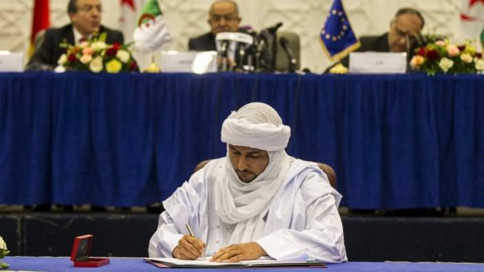 Bilal Agh Cherif, secretary general of The Coordination of the Movements of Azawad (CMA), signs a preliminary peace agreement in Algiers, Algeria