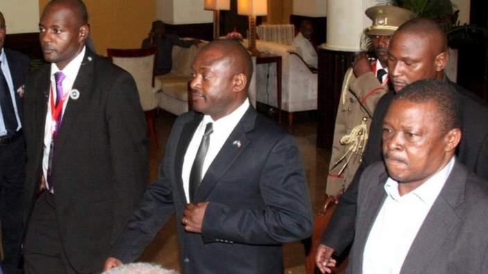 Burundi President Pierre Nkurunziza (C) is escorted on his way to the Julius Nyerere International Airport in Dar es Salaam, Tanzania