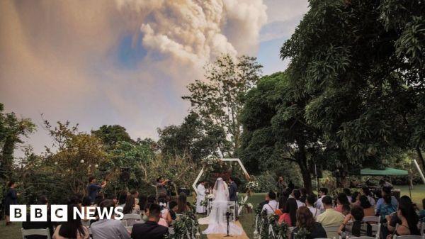 Taal volcano provides backdrop to wedding photos
