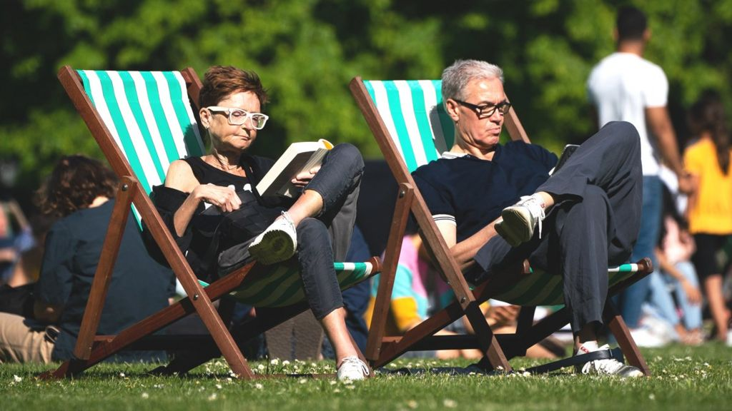 In deckchairs in the park