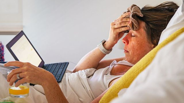 Woman in bed with flu