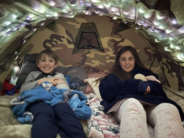 Lucy and Zachary Preston in tent