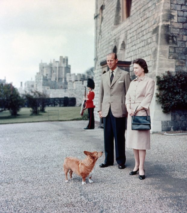 Prince Philip and the Queen with one of their dogs