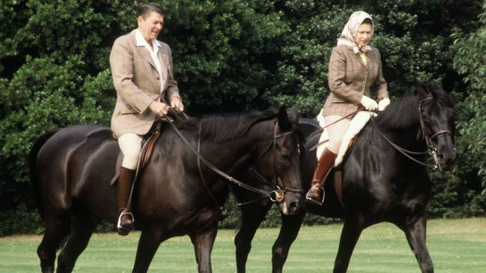 US President Ronald Reagan horse riding with the Queen at Windsor in June 1982