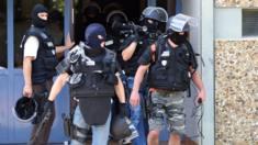 Counter-terror police at the suspect's home