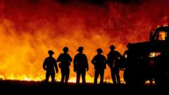 Firefighters in front of California wildfire